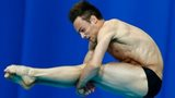Tom Daley performs a tuck