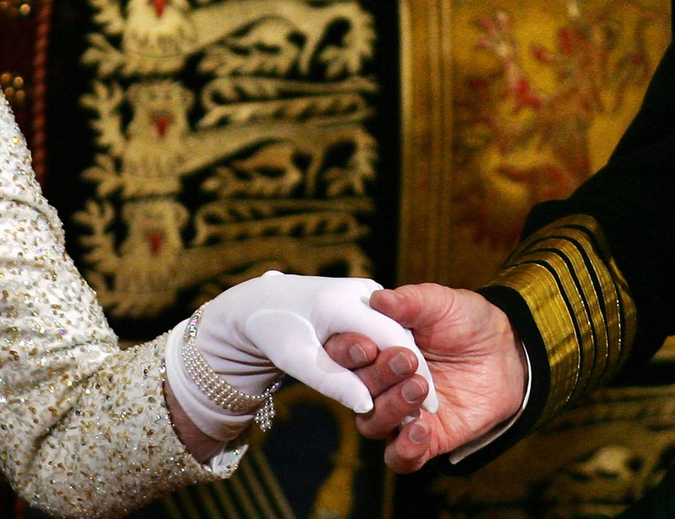 The Queen and Prince Philip hold hands
