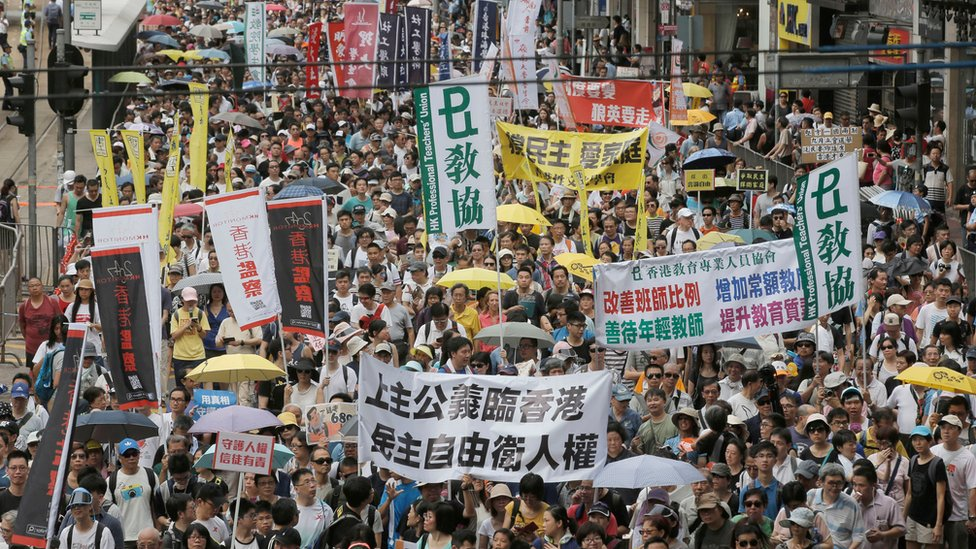 Tens of thousands at HK protest amid bookseller's safety fears