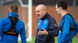 Rangers manager Mark Warburton passes advice during training