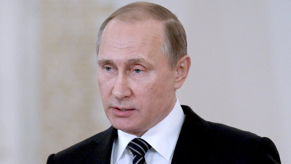 Russia's Putin visits Syria airbase and orders start of pullout