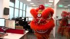 A Chinese lion on its way towards the BBC's new Singapore studio