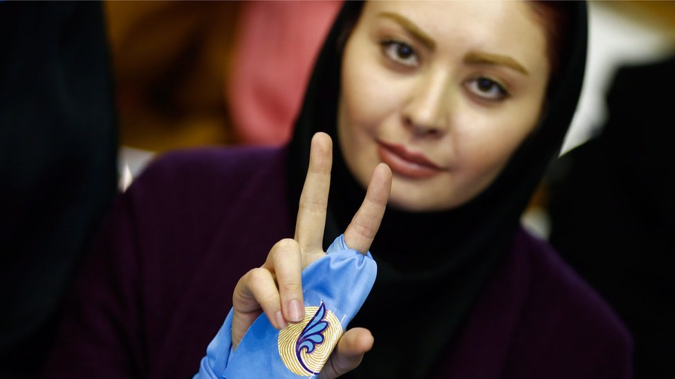 An Iranian supporter of reformist group flashes victory sign during the first reformists election campaign in Tehran, Iran, 18 February 2016