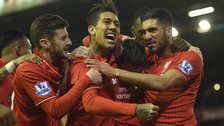 Liverpool players celebrate their winner against Swansea
