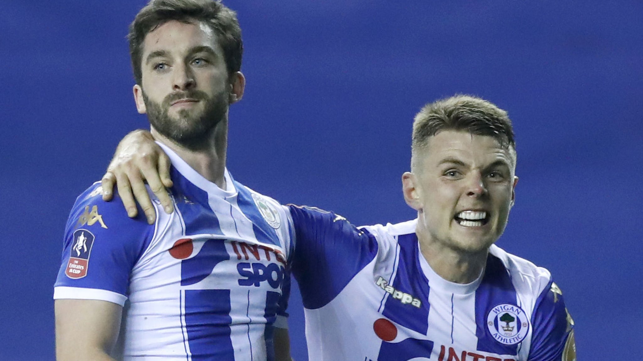 League One Wigan stun Man City in FA Cup shock