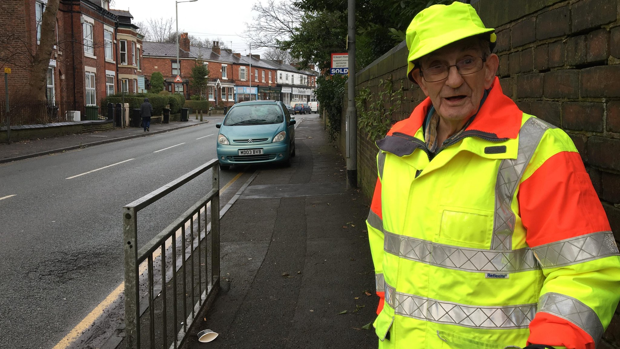 Stockport lollipop man in high-five school ban