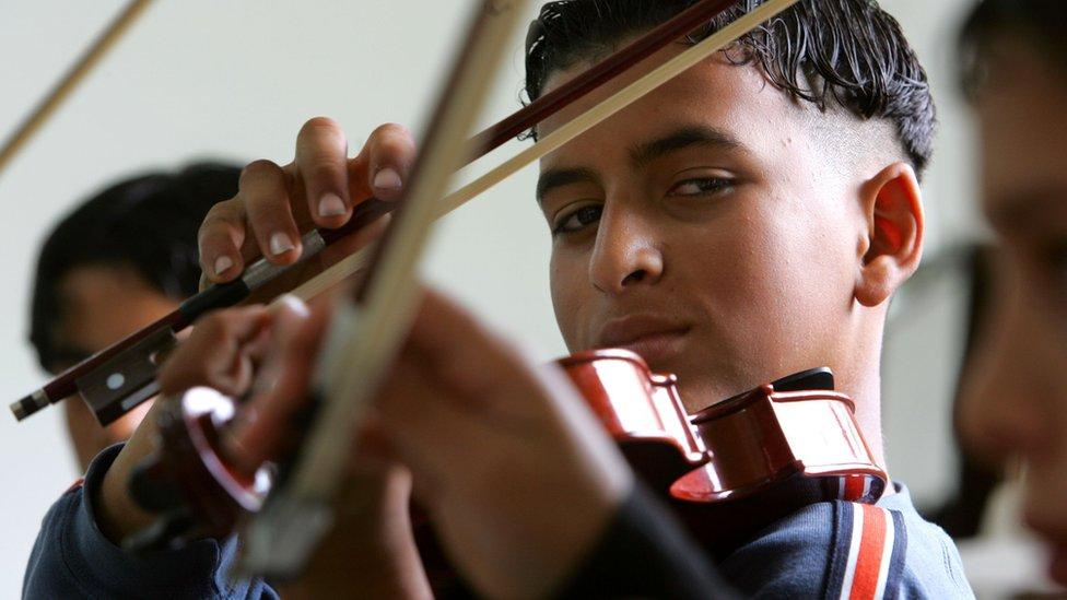 A boy plays the violin