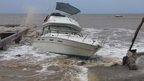 Boat battered during tropical storm