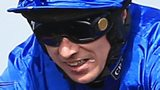 Paddy Brennan riding Cue Card to victory in the Betfred Bowl Steeple Chase at Aintree