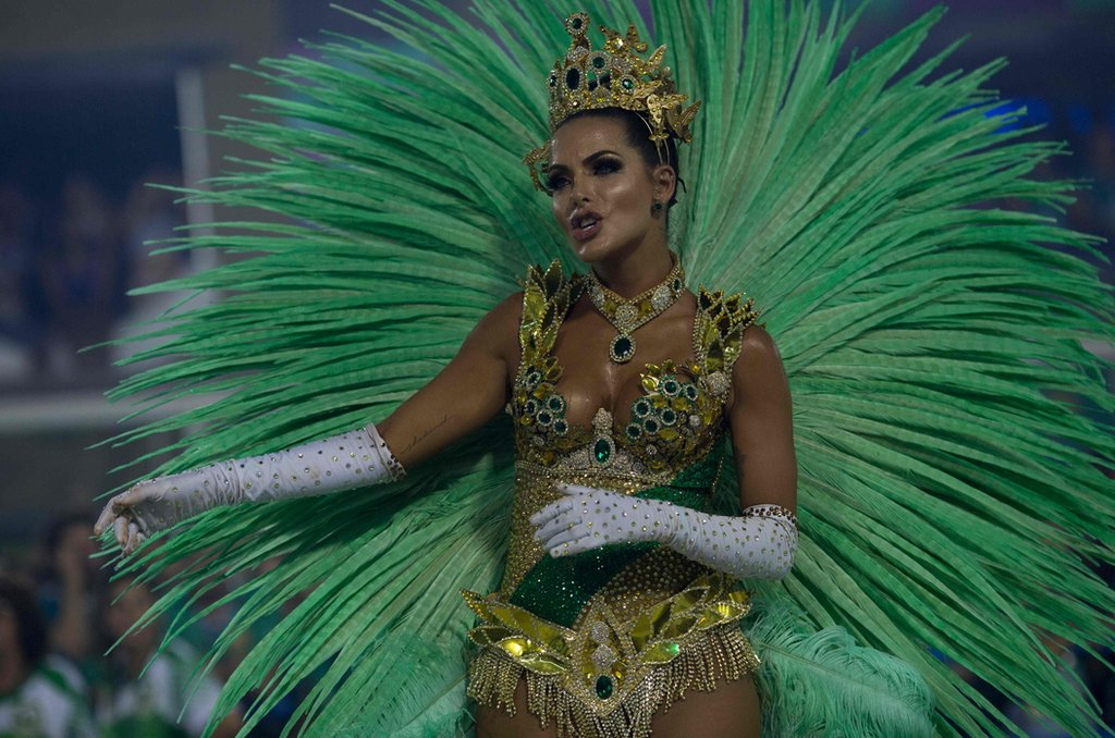 """A reveller of the Imperatriz Leopoldinense samba school performs during the second night of Rio""""s Carnival at the Sambadrome in Rio de Janeiro, Brazil, on February 13, 2018. / AFP PHOTO / Mauro PIMENTELMAURO PIMENTEL/AFP/Getty Images"""