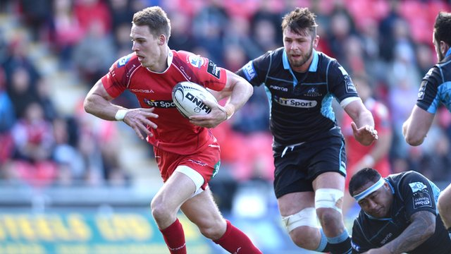 Liam Williams of the Scarlets beats the Glasgow defence to score his team's only try against the Warriors