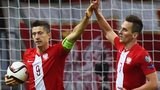 Poland's Robert Lewandowski and Arkadiusz Milik celebrate