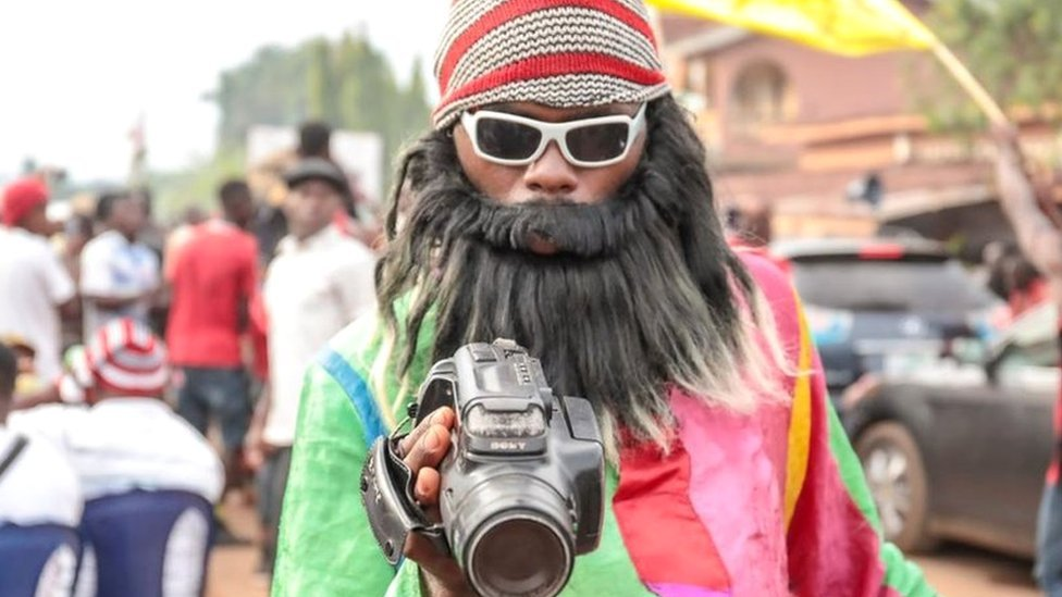 In pictures: Wearing fancy dress for big yams in Nigeria