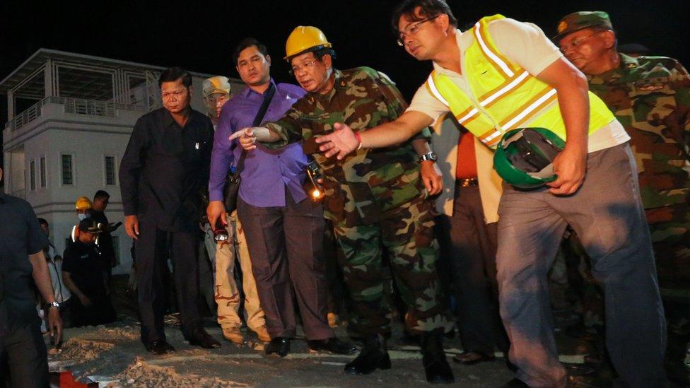 Cambodia PM Hun Sen visits deadly building collapse site