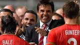 Wales players and management celebrate Gareth Bale's winning goal against Cyprus