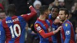 Wilfried Zaha celebrates with team mates