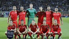 The Wales team lines up before the game in Zenica
