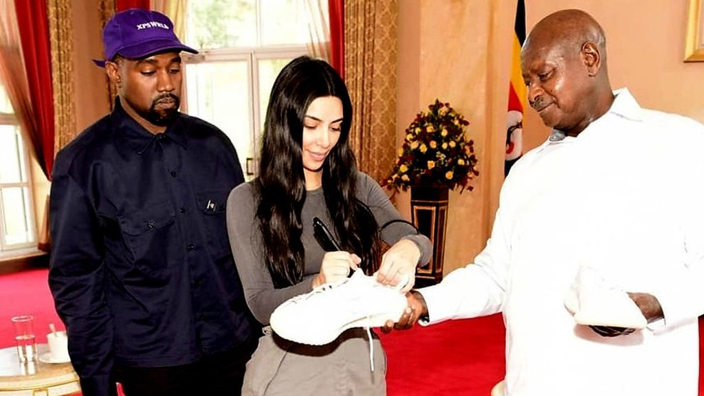 Kanye West and Kim Kardashian present Yeeezy sneakers to Uganda's Yoweri Museveni