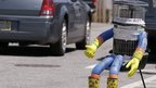 File picture of robot, HitchBOT, thumbing a lift in Marblehead, Massachusetts