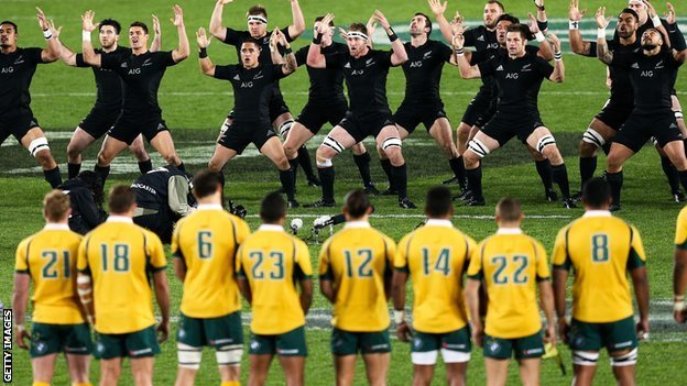 Australia look on as New Zealand perform the haka before they met this summer in Auckland