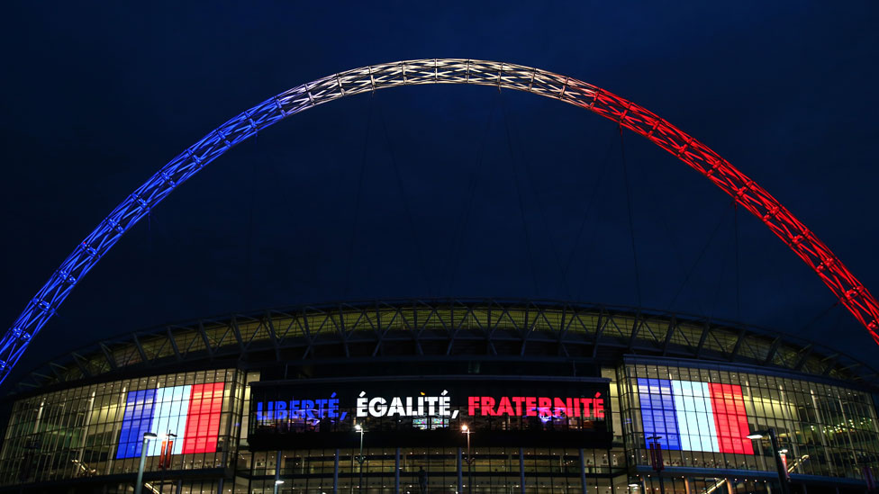 Wembley stadium is lit up in the French Tricolore in remembrance to the victims of last weeks terror attacks in Paris