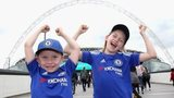Chelsea fans pose in front of Wembley before the FA Women's Cup final