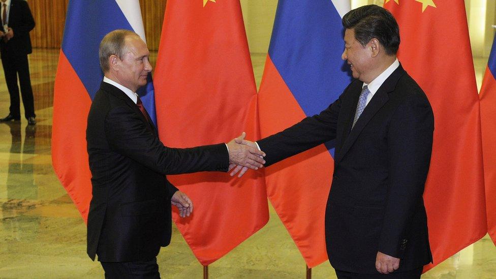 習近平(右)接見普京(左)(資料圖片)
