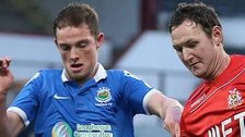 Linfield's Reece Glendinning in action against Gary Twigg of Portadown