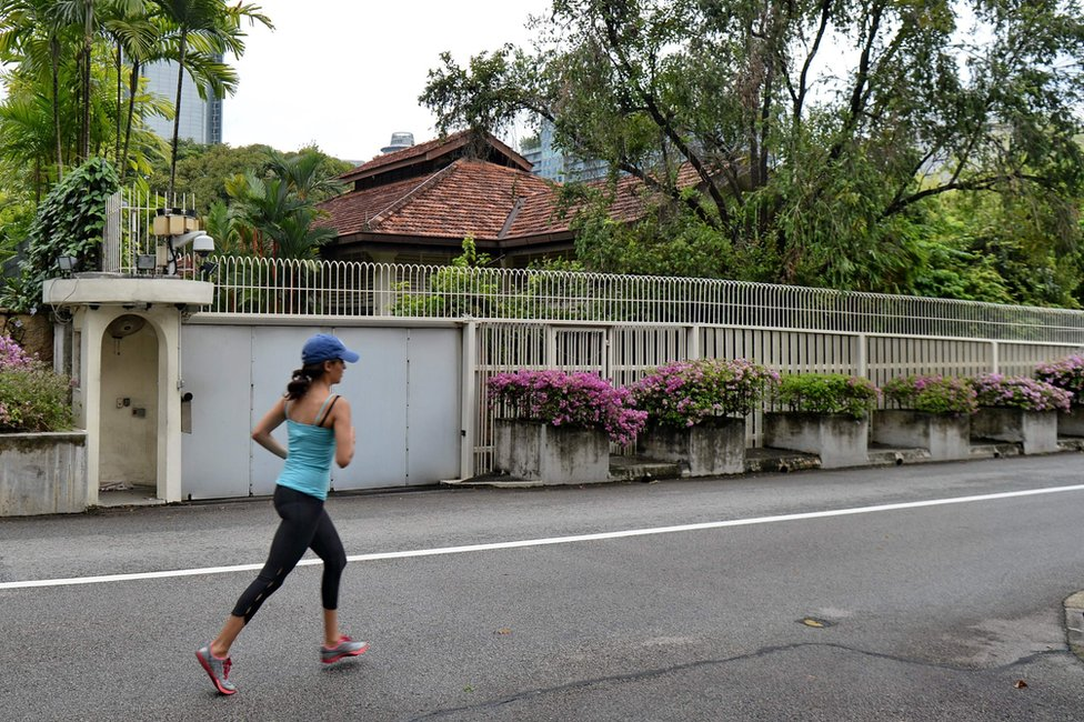 """A woman jogs past the house of Singapore""""s late prime minister Lee Kuan Yew on 38 Oxley Road in Singapore on 3 July 2017."""