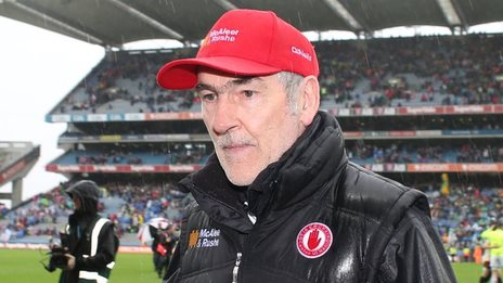 Tyrone manager Mickey Harte walks off the pitch after Sunday's semi-final