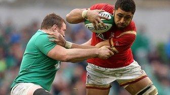 Taulupe Faletau is tackled by Jack McGrath