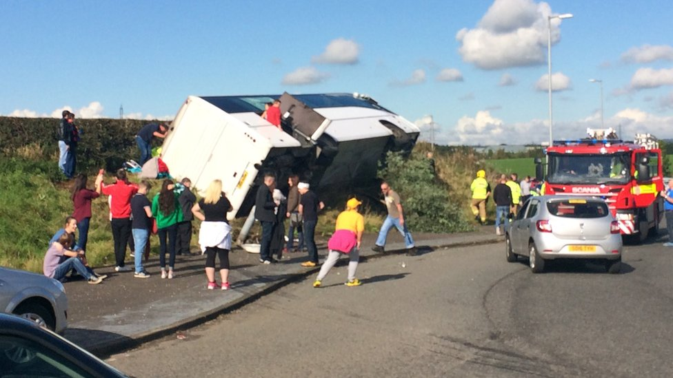 One man dead after Rangers fans' coach crash