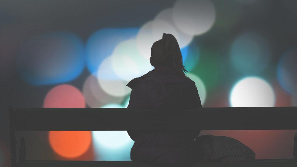 Diabetes programmes logo - image of woman sitting on bench