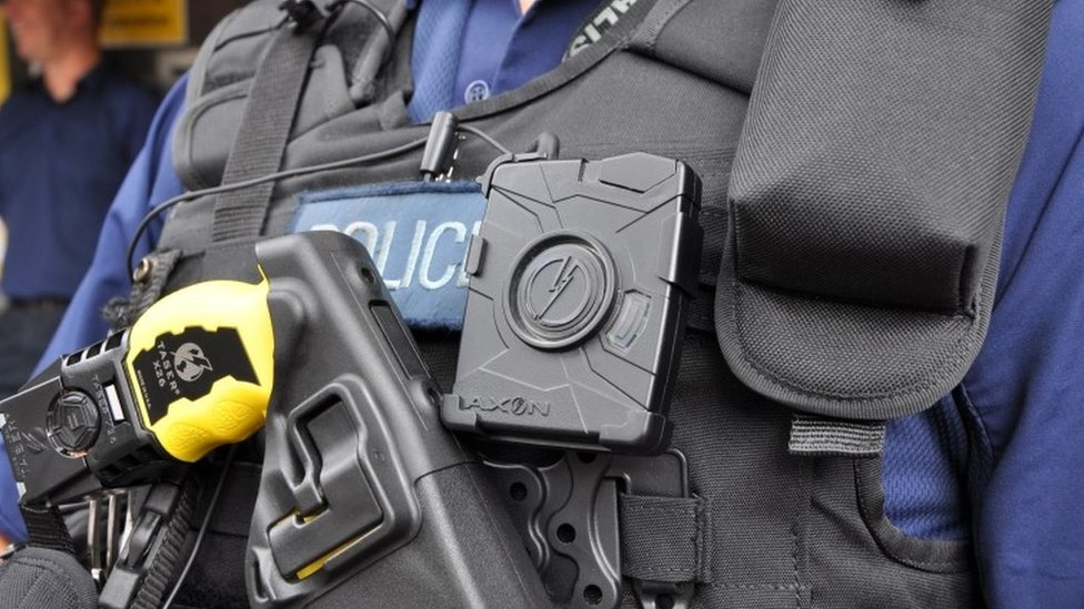 Police officer wearing body-worn video camera