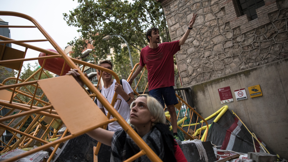 Pro-referendum supporters create a barricade to prevent police officers gaining entry inside the Escola Industrial of Barcelona school polling station ahead of the closing of the polls on October 1, 2017 in Barcelona, Spain