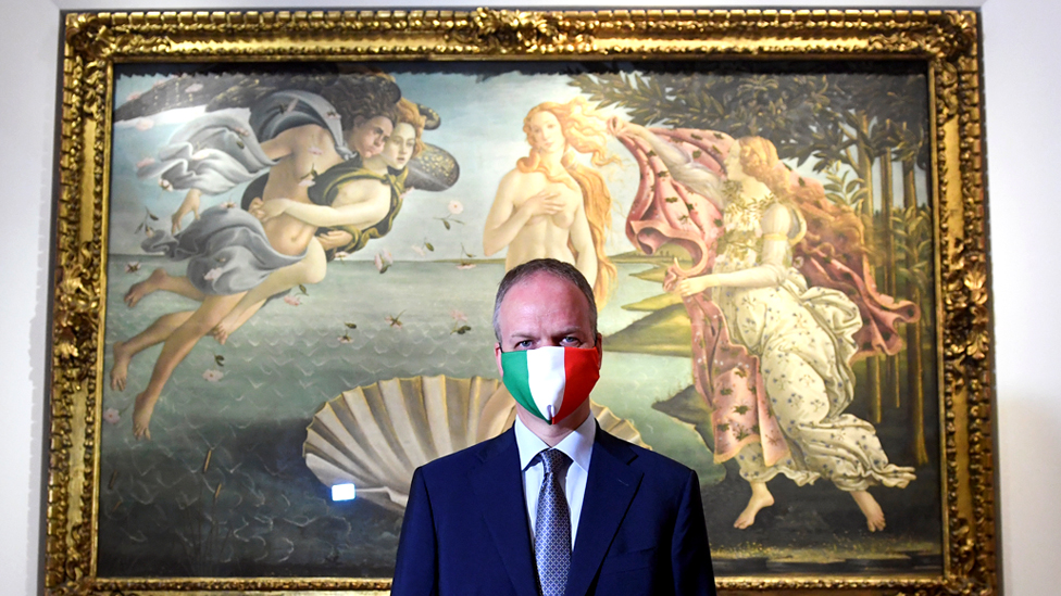 Director of the Uffizi Gallery Eike Dieter Schmidt poses with a face mask in front The Birth of Venus painting by Sandro Botticelli