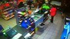 Shop worker confronts robber