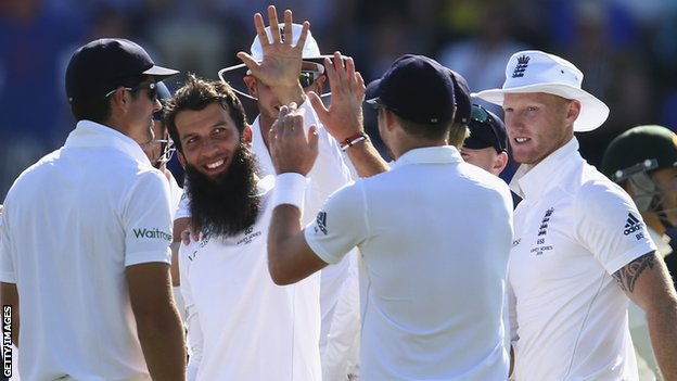 Moeen Ali (centre) celebrates with team-mates