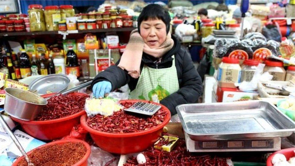 চীন কেন যুক্তরাষ্টের সাথে বাণিজ্য চুক্তি করার চাপে রয়েছে
