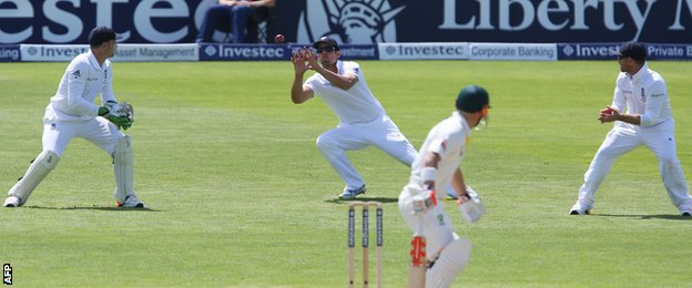 Alastair Cook catches David Warner off the bowling of James Anderson