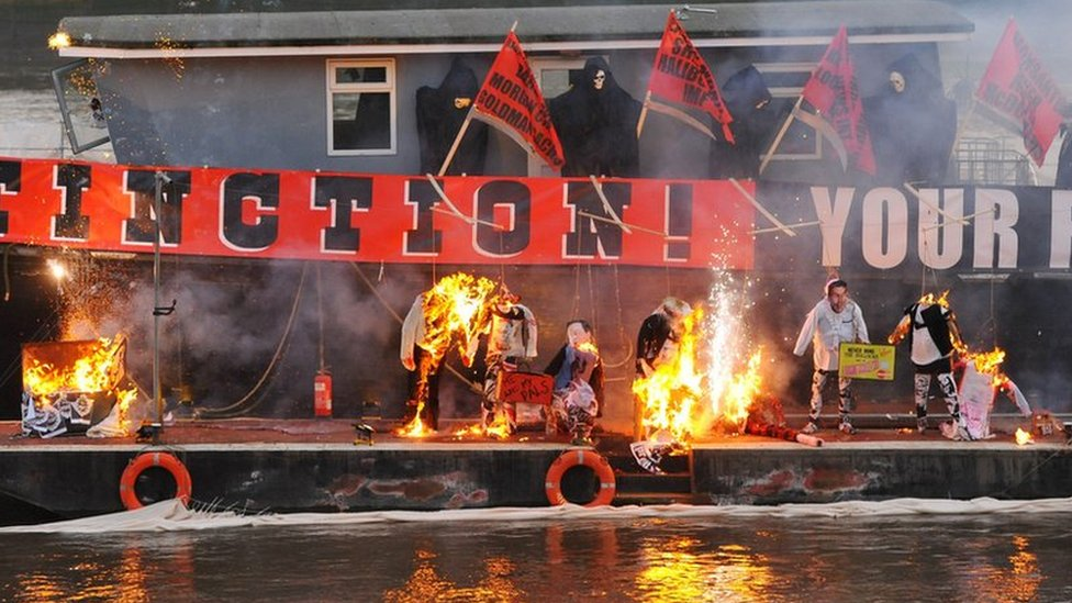 BBC News - Punk protest: Sex Pistols manager's son sets fire to collection