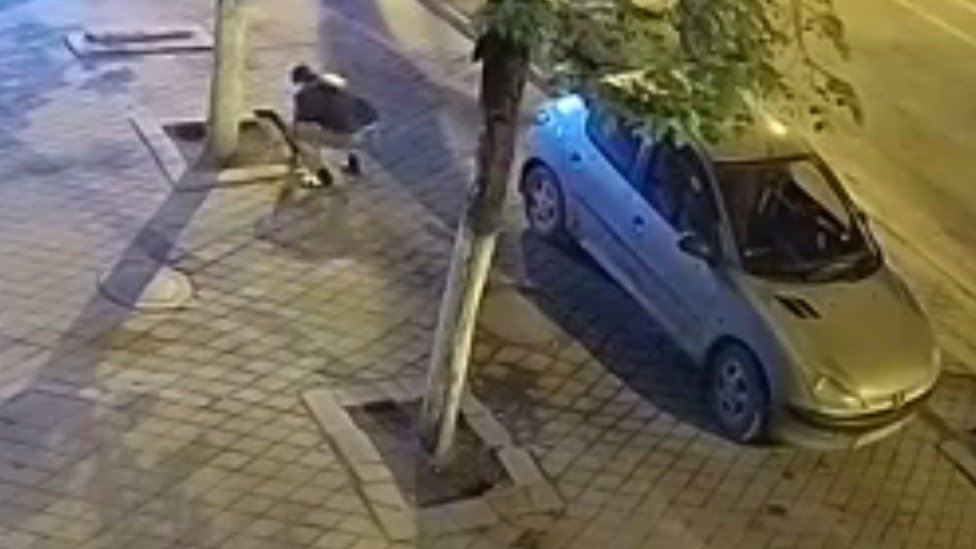 Man stealing paving stones