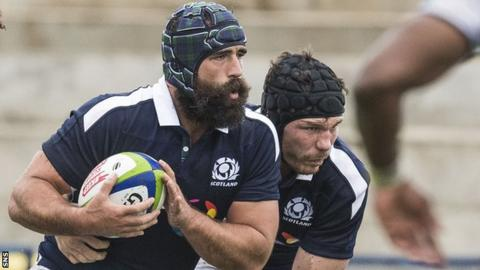Rugby protective headgear 'cuts impact by almost half'