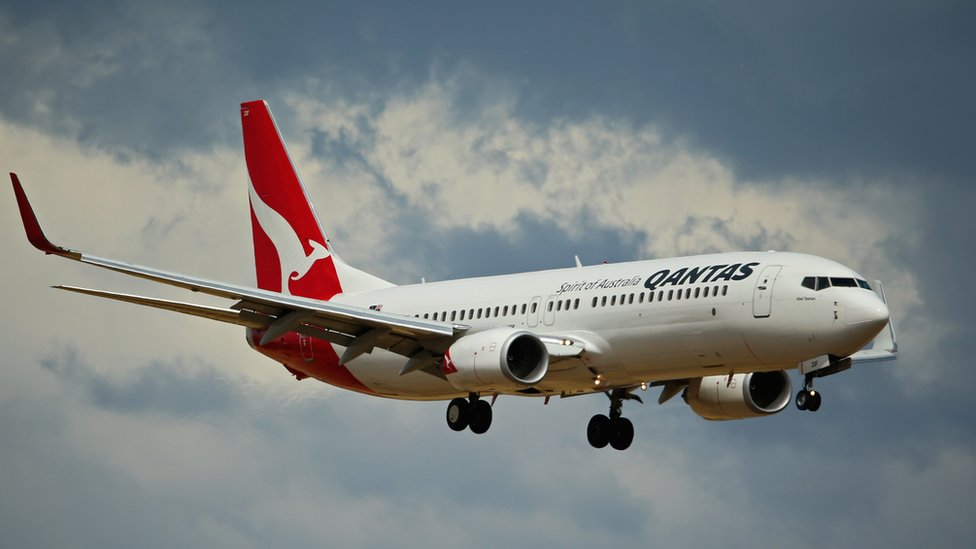 Qantas airline soars to record profit after restructuring