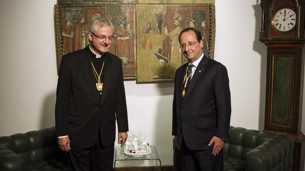 The Spanish Bishop of Urgell (l) and the president of France (r) are Andorra's co-princes and heads of state