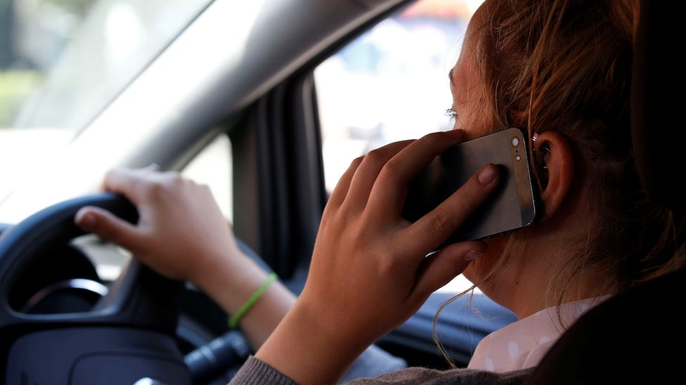 Thousands of drivers caught in mobile phone crackdown