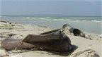 Migrants' belongings on the beach at Zuwara