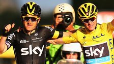 Geraint Thomas and Chris Froome cross the finishing line at the end of the 2015 Tour de France