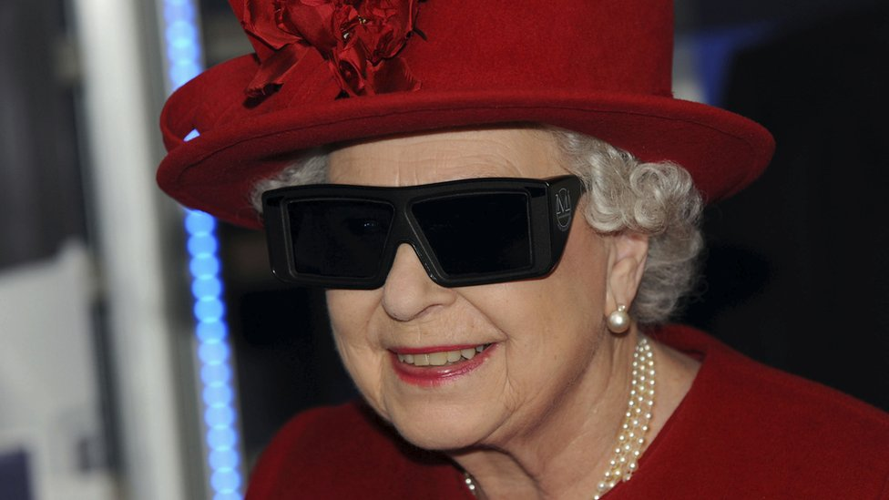 The Queen wearing 3D glasses