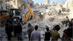 Civil defence members search for survivors after airstrikes by pro-Syrian government forces